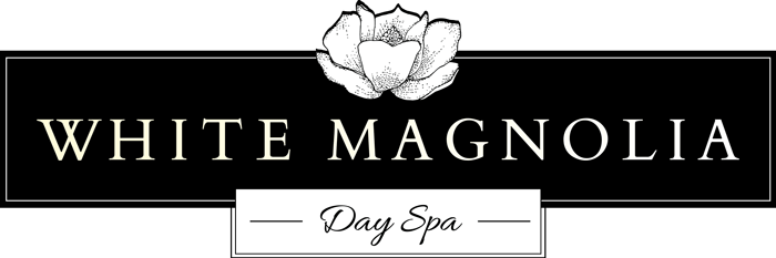 The White Magnolia Day Spa logo